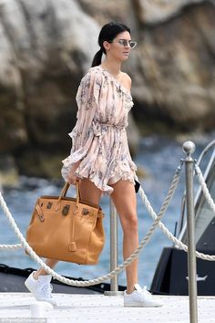 Kendall Jenner wearing Hermes Birkin Bag, Le Specs X Adam Selman the Last Lolita Sunglasses and Adidas Originals Stan Smith Sneakers in White