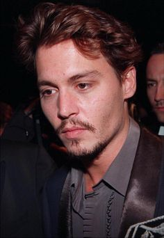 Johnny with Kate Moss at the premiere for the movie Fear and Loathing in Las Vegas at the Cannes Film Festival on May 15th, 1998.