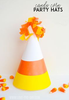 Kids Halloween Party Ideas:: Candy Corn Party Hats from MichaelsMakers Love The Day