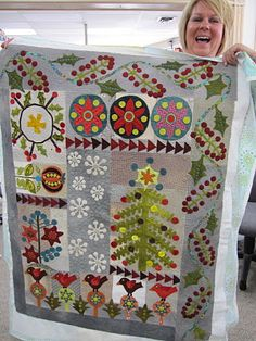 Sue Spargo class CHRISTMAS QUILT - I like some of the individual elements - the tree, snowflakes, hollyberries.