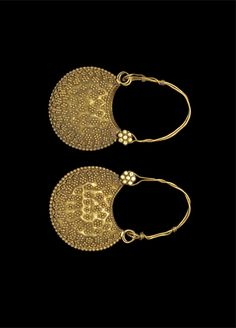 Byzantine gold earrings, c. A pair of gold lunate earrings each with a twisted wire loop and floral stud pin supporting a hollow bifid crescent pendant with granule decoration in lines, lozenges and flowers. Byzantine Gold, Byzantine Jewelry, Medieval Jewelry, Ancient Jewelry, Antique Jewelry, Vintage Jewelry, Viking Jewelry, Greek Jewelry, Gold Jewelry