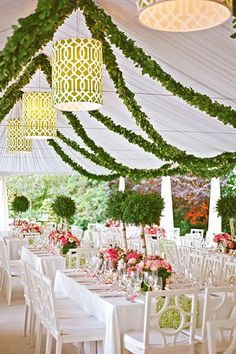 Bring the outdoors in with charming topiary centerpieces and a garland-draped ceiling.