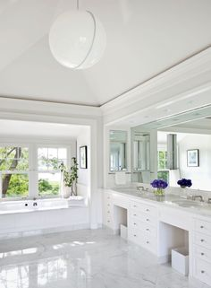 Inside an East Hampton, New York, home refreshed by Shelton, Mindel & Assoc., a marble-floored bath includes an acrylic pendant light from ABC Carpet & Home. Dream Bathrooms, House Design, Bathroom Interior, Marble Bathroom Floor, White Marble Bathrooms, Hamptons House, White Bathroom, Architectural Digest, Contemporary Bathroom