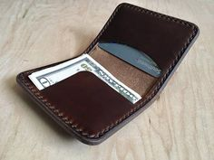This minimalist folding wallet holds 5 cards in the right pocket (more after it breaks in). The left side can hold cards and once-folded cash in the flap. Measures approximately 3 1/4 inches by 4 inches when folded. Made from 6 oz and 3 oz Horween Brown Chromexcel. Chromexcel (CXL) is