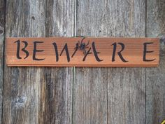 Beware presents an ominous warning especially as spooky black spider climbs about. Black lettering on natural redwood. Approx. 15x3 Has cording for hanging.  Each sign is naturally distressed, reclaimed, salvaged and/or chipped old wood (which was destined for, but saved from the dumps). Each comes with cording or saw tooth hanger for hanging.  This is for the Beware sign only. Other photos are are of other items in my shop. . *Perfect for Your Halloween Décor, Gift, or Your Witchy Display…