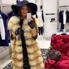 Sleeveless fox fur coat & awesome hat