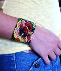 Working in a shed slightly larger than the size of a telephone booth, Rosita makes works of art every day. Inspired by traditional belts worn by women in Guatemala, these bracelets tell a story you can wear! * Czech glass beads * Adjustable 7 - 8 * Handmade in Guatemala * Fair Trade  ** Wholesale pricing available*  --FREE BRACELET WITH EVERY ORDER! See last image for the free bracelet you will receive. Only one free bracelet per order