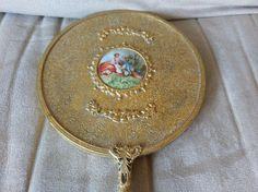 Check out this item in my Etsy shop https://www.etsy.com/listing/537756866/limoges-hand-held-vanity-mirror-with