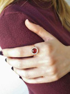 Pink tourmaline engagement ring, Unique engagement ring, Diamond halo ring, Rose gold engagement ring, White Diamond Gold Ring, Solid 18K rose gold ring  Delicate, one of a kind engagement ring with a rose cut pink/salmon tourmaline and white diamond halo in rose gold 18K.  21 round brilliant cut white diamonds and 1 rose cut pink/salmon tourmaline. Weight of white diamonds: 0.36ct, size: 1,7mm. Weight of tourmaline: 2ct, size: 7mm Clarity of diamonds is VS-SI, Color G. Band size: 1...