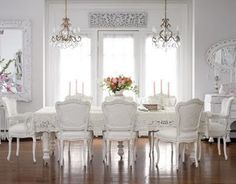 I would have to fight the constant urge to come to diner ever night in an evening gown if I knew that this endlessly gorgeous table and set of stately white chairs was waiting for me...like all the painted white pieces