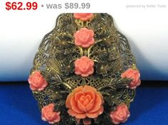 30% off Sale A #vintage #coral #plastic #floral dress clip.  This item is made up of an old #gold tone filigree metal which looks amazing.  This metal has a number of gold tone gilt floral d... #diamonds #rings #necklace #flowers #judysgems2 #christmas #sale #gift