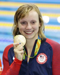 #RIO2016 Katie Ledecky of the United States shows the gold medal she won in the women's 800meter freestyle swimming final at the Rio de Janeiro Olympics on...
