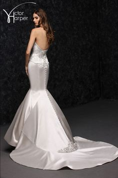 Scattered crystal embellished sweetheart neckline fit and flare wedding dress with fullback flounce train.  Sampled in Pearl Also in Diamond White and Ivory