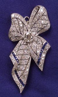 Art Deco Platinum, Diamond and Sapphire Bow brooch.