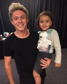 Niall with a little girl, so cute!!!!
