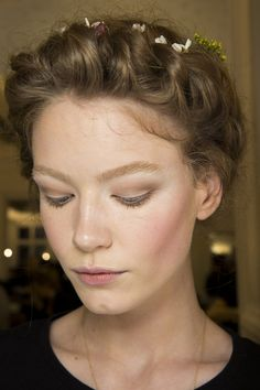 Valentino SS15 - Pat McGrath created a pretty, romantic look at the Valentino show, with flushed cheeks and lightly contoured eyes.