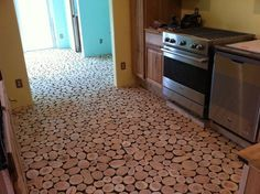 Cordwood flooring with instructions. If we can't save the floors in the kitchen, maybe this would be an option?