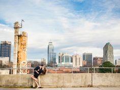 Steve and Caroline with the Raleigh skyline. Boylan Heights.