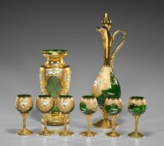 Set of Enameled Bohemian GlasswareEight piece set of enameled and gilt Bohemian green glassware, including: bottle fo. on May 2014 Crystal Glassware, Ceramic Materials, Vintage Dishes, Cutlery, Bohemian, Vase, Ceramics, Antique, Bottle