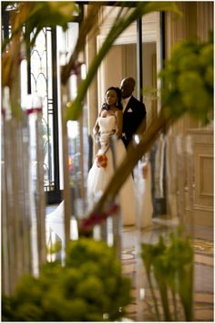 Bride and groom steal a moment in the @Four Seasons Hotel George V Paris lobby.