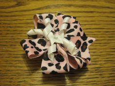 medium animal print bow with curled ribbon as an accent. Made with 1/2 in ribbon and alligator clip   $3.25  https://www.etsy.com/listing/108418449/pink-animal-print-bow