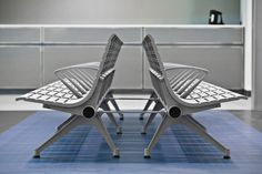 """Tecno RS Seating system shown in backed configuration with Silver Texture powdercoated frame and seats, horizontal armrests with custom finish and """"V"""" legs with back-to-back linking elements, freestanding"""