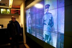 Moscow cinema ends showings of banned Stalin film - January 26, 2018.  A screen in Pioner movie theater shows an episode from the Death of Stalin film in Moscow, Russia, Thursday, Jan. 25, 2018. A Moscow movie theater has shown a satirical film about Soviet leader Josef Stalin despite an official ban. (AP Photo/Alexander Zemlianichenko)