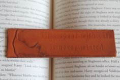Hand carved, hand dyed, genuine leather bookmark  Bookmark is 5.25x1.5 inches    As with any handmade product, some imperfections may exist that