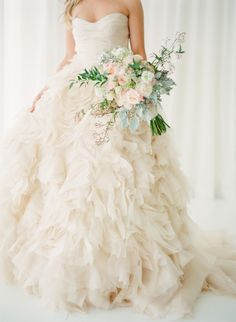 Fluffy wedding dress heaven: http://www.stylemepretty.com/2014/05/28/romantic-glamour-in-miami/ | Photography: KT Merry - http://www.ktmerry.com/