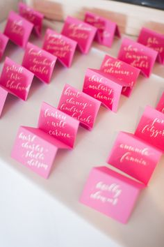 Whimsical Pink Calligraphy Escort Cards | Natalie Grace Calligraphy | Jess Barfield Photography https://www.theknot.com/marketplace/jess-barfield-photography-dallas-tx-258717