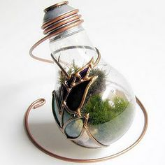 bright ideas for incandescent bulbs (pictured here is a mini terrarium)... they are all so beautiful...luv all the posts of trashy wench...