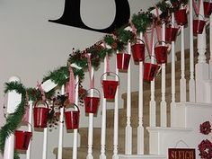 Sorta like this idea, too.  I always put garland on our banister anyway...