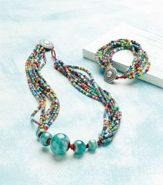 """""""Globe-trotter"""" necklace and bracelet by Erin Siegel, published in Jewelry Stringing Magazine Spring 2014"""