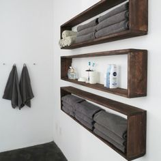 Build and mount this simple set of wooden shelves to easily double—if not triple—the existing storage in your bathroom.