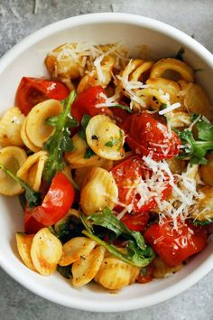 """NYT Cooking: Orecchiette are formed by kneading the dough, letting it rest, then breaking off portions to roll by hand into long skinny ropes. These are cut into pieces, formed into rounds and given the classic cup shape between the index finger and thumb, then flipped inside-out to expose the slightly more textured inner surface that will """"grab"""" the sauce."""