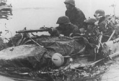 The Volkswagen Schwimmwagen was an amphibious vehicle used extensively by the Wehrmacht and the Waffen-SS during the Second World War. 4th Infantry Division, German Helmet, Female Marines, German Soldiers Ww2, Germany Ww2, Tiger Tank, Tank Destroyer, Military Photos, Military History