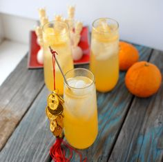 Happy Dragon cocktail. The Ginger-Infused Vodka and freshly sqeezed tangerine juice make this a unique. light and refreshing cocktail just in time for Chinese New Year.