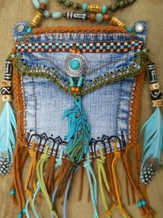 Great Ideas for Upcycling Those Old Jeans It would make a cute little purse for a kid I think by trista.day