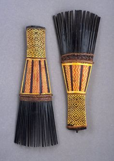 """Ornamental combs, used by men in dancing (""""faa""""). Solomon Islands, Malaita; early 20th c. H 21 cm. Made of palm wood and dyed plant fibre. Field collected in the 1930s; bought by us in the mid 90s. We are very happy with this beautiful pair. It is published in Truus Daalder, *Ethnic Jewellery and Adornment*, p. 152."""