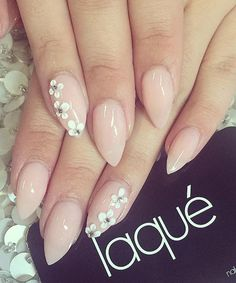 Pretty nude nail art design. A rather simple looking design that gives off a sophisticated aura, adding the tiny white flowers with silver beads on top just adds to its charm.