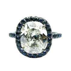 3.02carat Cushion Diamond with Sapphire Frame | From a unique collection of vintage engagement rings at http://www.1stdibs.com/jewelry/rings/engagement-rings/