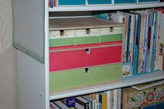 Ikea storage we covered with scrapbook paper.