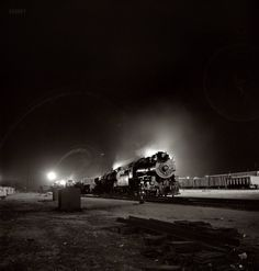 "March 1943. ""Barstow, California. A view of the Atchison, Topeka & Santa Fe yard at night."" Medium-format negative by Jack Delano."