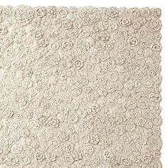 Natural Flora Crocheted Rug  100% wool with thick wool/felt backing. Handmade in India. Available in two sizes: 3 x 5' & 5 x 7'. Use with a rug pad (sold separately). For best results, vacuum regularly. Spot clean. (Item # RG51)        $495.00 - $895.00