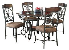 With the scrolling tubular metal bathed in a dark bronze color finish beautifully supporting the brown cherry finished tabletop and adorned with a decorative rope twist edge profile, the La Costa 5-piece dining set flawlessly captures the true atmosphere of classic old-world design to enhance the look of any dining room.