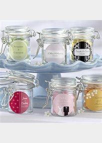 """Just like the classic, glass canisters you'll find in a contemporary kitchen, only smaller and sweeter! Fill the jars with a tasty treat, and treat your guests to a unique, miniature marvel. Features and facts:  * Glass jar has white-rubber gasket and metal locking device * Jar measures 1.75"""" x 2.5"""" including metal work * Personalized sticker available * Holds approximately 3.78 oz. & 40 pieces of small candy * Sold in a set of 12 Personalize your sticker selection with name…"""