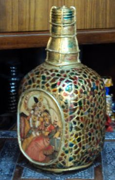 Just like that............Aesthetics in Art and Design : Recycled/ Painted Glass bottle.............glass turns to Gold