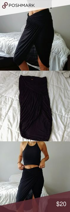 FREE PEOPLE DRAPED ASYMMETRIC BLACK SKIRT Beautiful asymmetrical draped black skirt. Has a short under lining so it isn't see through! Great condition, size XS. Free People Skirts Midi