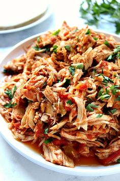 Slow Cooker Mexican Chicken Recipe - super easy and flavorful shredded chicken cooked in slow cooker! Use it in tacos, burritos, enchiladas and dips!