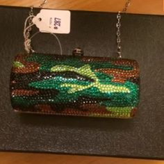 Swarovski Camo Clutch This mini sleek Swarovski bag has detachable chain link strap that can be worn as cross bag. Swarovski Bags Mini Bags